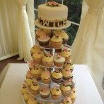 cupcake wedding cake with top tier and 'cwtch' in edible letters