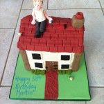 House cake with man on roof