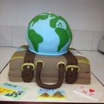 world cake on top of suitcase
