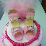 3 tier wonky cake with shoes, flowers and feathers