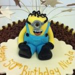 milk and white tube cake with handmade minion, despicable me cake