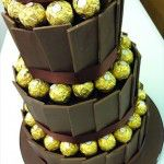 Chocolate panelled wedding cake with forrero rochers inbetween