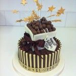 2 tier chocolate cake with box on top and maltesers