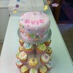 cupcakes with matching top tier and pastel flowers