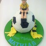 football cake with handmade supporter on top