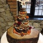 totally 'naked' wedding cake with no icing, fresh flowers and fruit