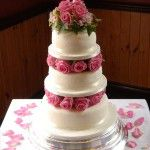 3 tiers separated with fresh roses