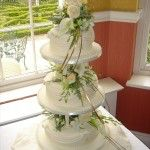 3 tier on pillars with fresh flowers