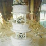 round cake with pillars and swags