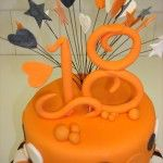 bright orange 18th birthday cake, stars and hearts on wires, stripes and spots