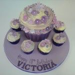 giant purple cupcake with matching little ones