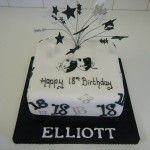 black white and silver cake with theatre masks