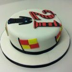 21 cake with referee kit, badge and flags