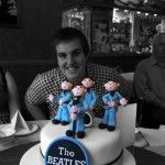 sam aylward with his beatles cake