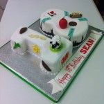 one and eight birthday cake with welsh and new york theme