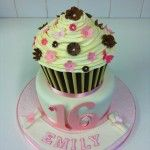 giant cupcake two tier cake, with white and milk chocolate tubes