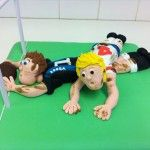 rugby themed cake with sugar models