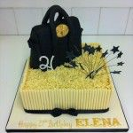 white chocolate tube cake with mulberry handbag on top