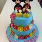 minnie and mickey cake with hawaiin flowers
