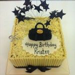 Mulberry handbag with black stars on wires, white chocolate birthday cake