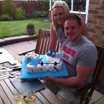 Happy Customer Luke Litchfield and Leah Davies with his 25th weight lifting cake