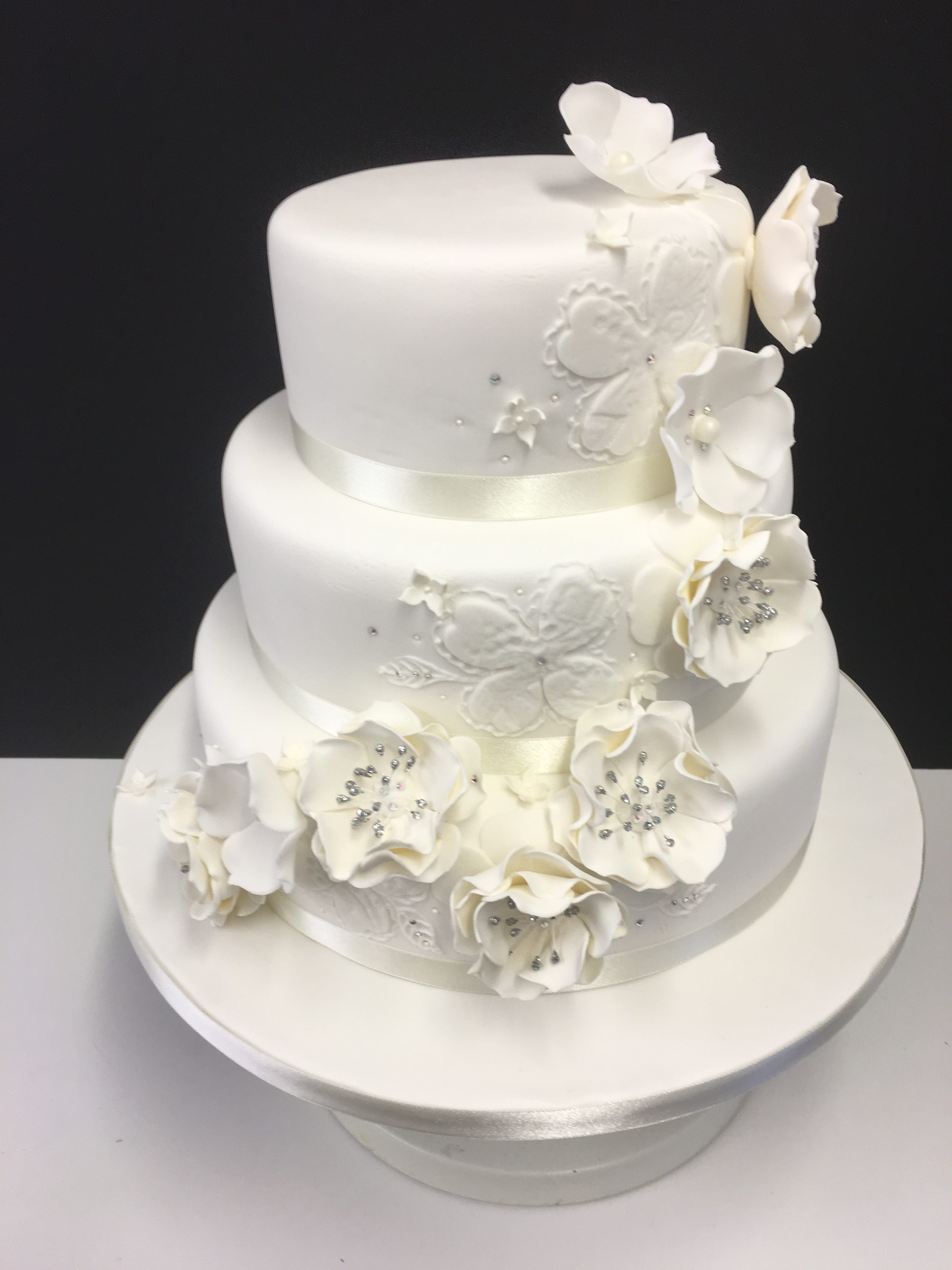 white iced wedding cake with white flowers and diamonte | Cakes for ...